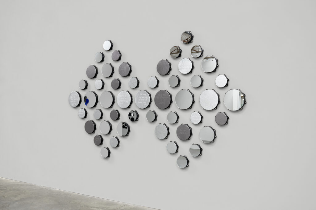 Two diamond shapes made of tambourines by Lava Thomas