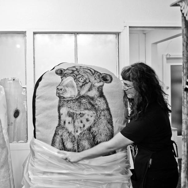 Artist Tara Tucker with big bear sculpture