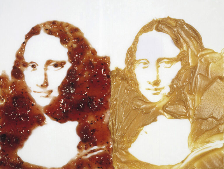 Two Mona Lisas made out of peanut butter and jelly
