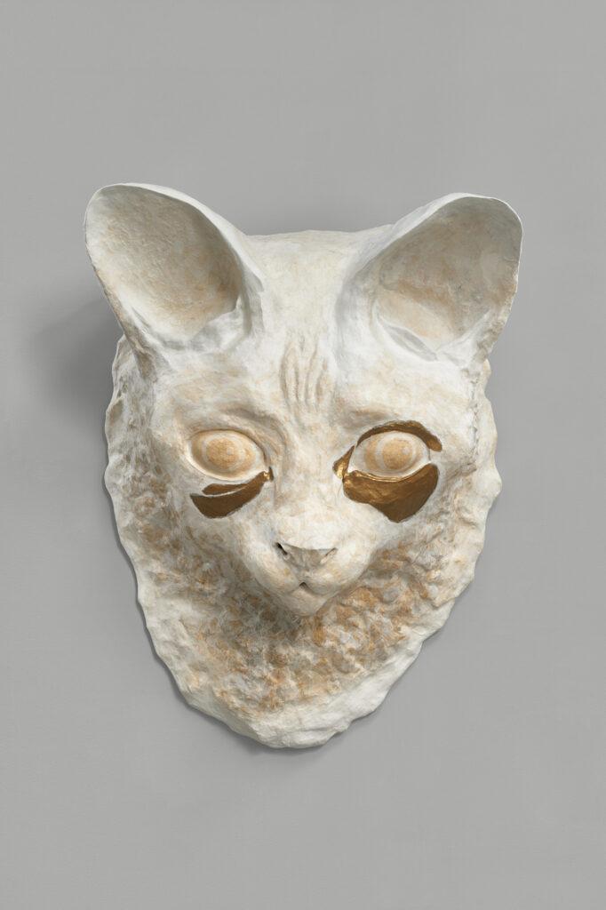 Cat head sculpture by Tara Tucker based on a photograph by Nan Goldin