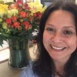 Jenny Baie with flowers